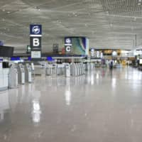 A Narita Airport terminal in eastern Japan is quiet on May 2 during the Golden Week holidays while the country is under a state of emergency over the coronavirus pandemic. | KYODO