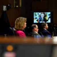 U.S. Sens. Lisa Murkowski, Mike Braun and Rand Paul (R-KY) listen as Dr. Anthony Fauci, director of the National Institute of Allergy and Infectious Diseases, answers questions during the Senate Committee for Health, Education, Labor, and Pensions hearing on COVID-19 on Tuesday.  | POOL / VIA REUTERS