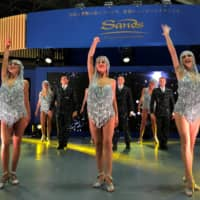 Dancers perform at the Las Vegas Sands Corp. booth at the Japan IR Expo in Yokohama in January. | REUTERS