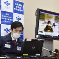 Osaka Gov. Hirofumi Yoshimura speaks during a videoconference about the coronavirus pandemic with his Tokyo counterpart, Yuriko Koike, from his prefectural government office in the city of Osaka on May 2. | KYODO