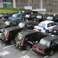 Taxis wait for customers at JR Nagoya Station in central Japan on April 16 amid the coronavirus pandemic. | KYODO