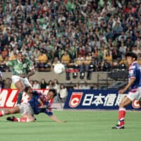 Verdy Kawasaki forward Hennie Meijer (second from left) scores the first goal in J. League history in the inaugural match against Yokohama Marinos on May 15, 1993, at the old National Stadium. | KYODO