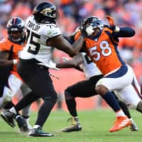 Broncos linebacker Von Miller tries to get past Jaguars offensive tackle Jawaan Taylor in the fourth quarter of their game on Sept. 29, 2019, in Denver. | USA TODAY / VIA REUTERS