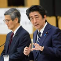 Prime Minister Shinzo Abe speaks during a news conference at the Prime Minister's Office in Tokyo on Thursday.  | POOL / VIA AFP-JIJI