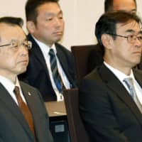 Hiromu Kurokawa (right), chief of the Tokyo High Public Prosecutor's Office, attends a meeting at the Justice Ministry in February. | KYODO