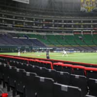 The Fukuoka SoftBank Hawks and Chiba Lotte Marines play a practice game behind closed doors at PayPay Dome in Fukuoka on March 20, the scheduled opening day of the NPB season. | KYODO