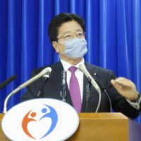 Health minister Katsunobu Kato speaks at a news conference at the ministry Friday. | KYODO