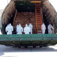 A cargo plane carrying protective masks from China is unloaded at the airport in Leipzig, Germany, on April 27. | REUTERS