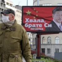 A billboard depicts Chinese President Xi Jinping in Belgrade, Serbia, on April 1. | REUTERS