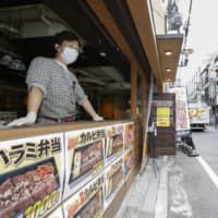 A barbecue restaurant in Osaka reopens Friday after the Osaka Prefectural Government judged the previous day that it had met its self-imposed criteria for resuming some economic activities. | KYODO