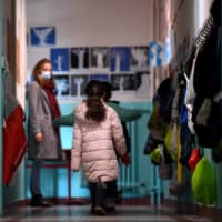 Children prepare to enter their classroom at a school in Paris on Thursday. U.S. health authorities issued an alert the same day over a rare but sometimes deadly autoimmune condition among children that is believed to be linked to COVID-19. | AFP-JIJI