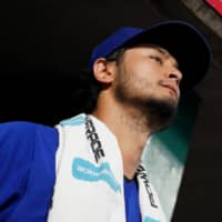 Cubs starting pitcher Yu Darvish stands in the dugout during a game against the Reds in Cincinnati on Aug. 9. | USA TODAY / VIA REUTERS
