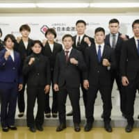 Japan's Olympic judo squad poses at a news conference in February at the Kodokan in Tokyo. All Japan Judo Federation officials have decided that judoka will not have to qualify again for the Tokyo Games, which have been postponed to 2021. | KYODO