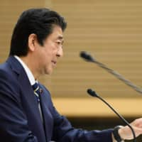 Prime Minister Shinzo Abe speaks during a news conference at the Prime Minister's Office in Tokyo on Thursday. Abe said the following day that Japan will call for an investigation into the World Health Organization's initial response to the coronavirus pandemic. | POOL / VIA AFP-JIJI