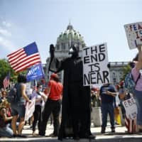 Protesters demonstrate during a rally against Pennsylvania's coronavirus stay-at-home order at the state Capitol in Harrisburg on Friday.   AP