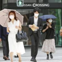 With more people wearing masks due to COVID-19, various initiatives have been launched that are aimed at reducing the risk of heat exhaustion. | KYODO