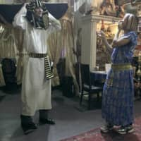 Walk like an Egyptian: Shion (left) and Hana try on Egyptian outfits while out to dinner on 'Terrace House Tokyo 2019-2020.' | © FUJI TELEVISION / EAST ENTERTAINMENT