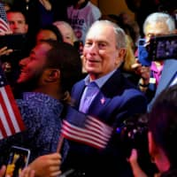 Then-Democratic U.S. presidential candidate Michael Bloomberg greets supporters during his Super Tuesday night rally in West Palm Beach, Florida, on March 3. | REUTERS