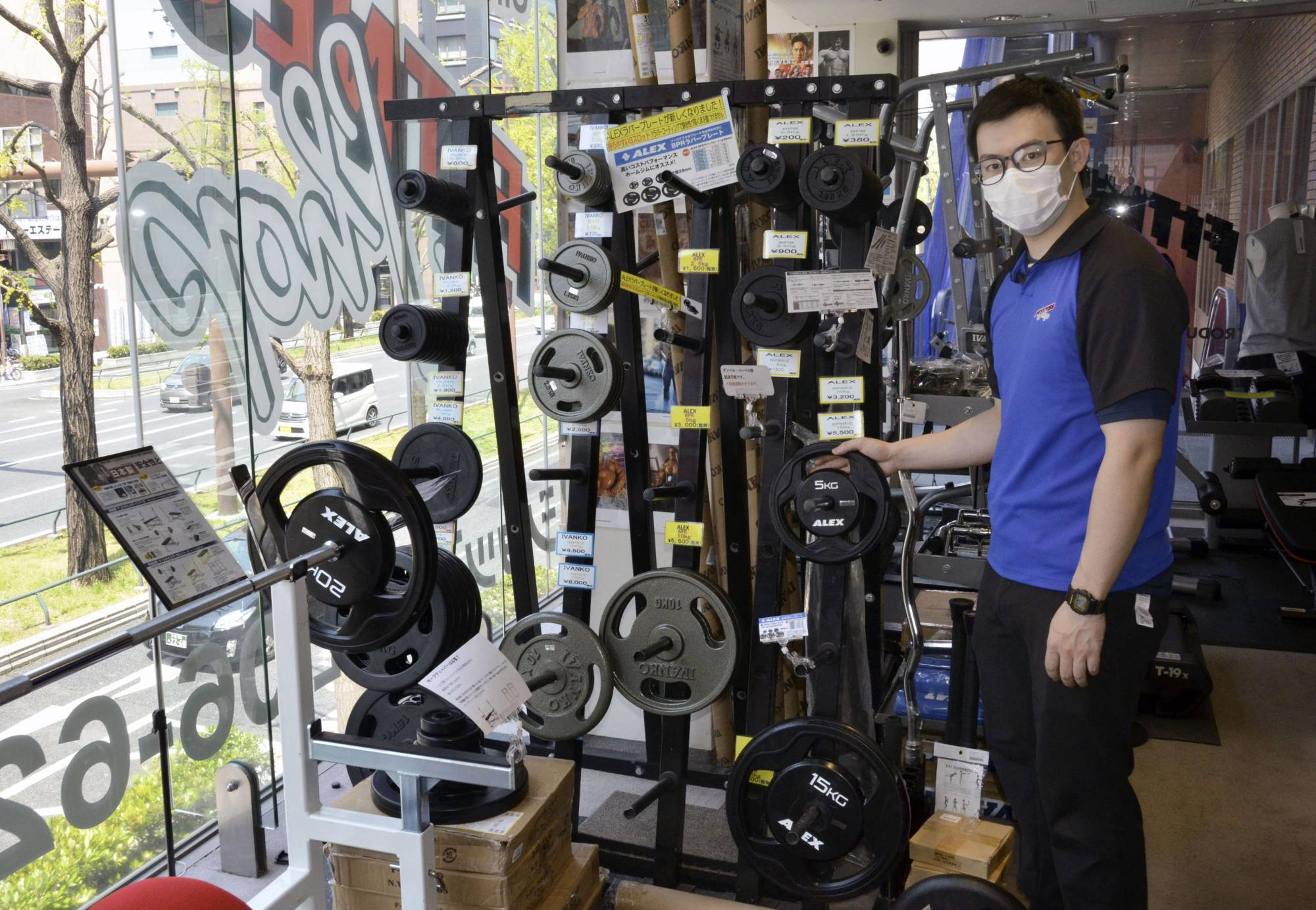 Pump it up: A store selling fitness equipment in Osaka is doing good business as gyms close and people stock up for at-home workouts. | KYODO