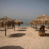 A beach near Athens on Friday, a day before it officially opened to the public. | AFP-JIJI