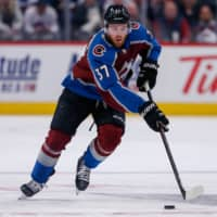Avalanche left wing J.T. Compher controls the puck against the Senators during a Feb. 11 game in Denver. | USA TODAY / VIA REUTERS
