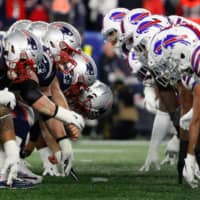 The Buffalo defense (right) and New England offense wait for the snap during a game on Dec. 21, 2019, in Foxborough, Massachusetts. | USA TODAY / VIA REUTERS