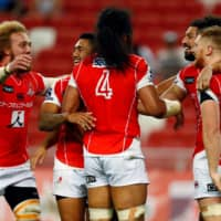 Sunwolves players celebrate after scoring a try against the Stormers during a Super Rugby match on March 17 at National Stadium in Singapore. | REUTERS