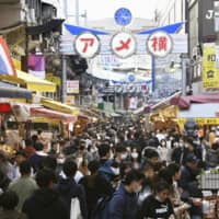 Second wave of COVID-19 cases inevitable in Japan, expert says