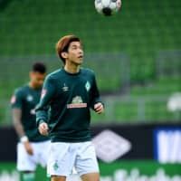 Werder Bremen's Yuya Osako warms up before a match against Bayer Leverkusen in Bremen, Germany, on Monday. | POOL / VIA REUTERS