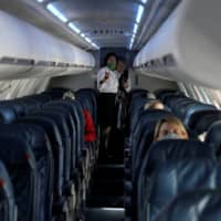 A nearly empty Delta Airlines flight operated by SkyWest Airlines prepares to depart from Salt Lake City, Utah, on April 11. | REUTERS