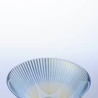 Golden glow: 'Asagao' ('Morning Glory') tea-ceremony bowl by Akane Yamamoto. Born in Ishikawa Prefecture in 1977, Kyoto resident Yamamoto won the Encouragement Prize of the Pola Award for the Promotion of Traditional Japanese Culture in 2015. Exquisitely wrought bands of gold glow from between two layers of glass, an effect achieved through a firing process that melts the glass just enough for the two pieces to fuse together without overheating the metal. |