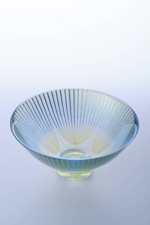 Golden glow: 'Asagao' ('Morning Glory') tea-ceremony bowl by Akane Yamamoto. Born in Ishikawa Prefecture in 1977, Kyoto resident Yamamoto won the Encouragement Prize of the Pola Award for the Promotion of Traditional Japanese Culture in 2015. Exquisitely wrought bands of gold glow from between two layers of glass, an effect achieved through a firing process that melts the glass just enough for the two pieces to fuse together without overheating the metal.