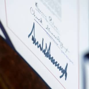 Done deal: U.S. President Donald Trump's signature is seen below the signatures of Speaker of the House Nancy Pelosi and U.S. Senate President pro tempore Sen. Chuck Grassley after the president signed the $2.2 trillion coronavirus CARES Act aid package bill into law on March 27. REUTERS/Jonathan Ernst | REUTERS