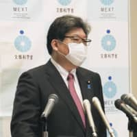 Education minister Koichi Hagiuda speaks during a news conference in Tokyo on Tuesday. | KYODO