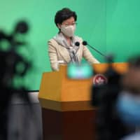 Hong Kong Chief Executive Carrie Lam listens to reporter's question during a news conference in the city Tuesday. | AP
