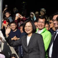 Taiwan President Tsai Ing-wen waves after casting a ballot during the presidential and legislative election in Taipei on Jan. 11.  | BLOOMBERG