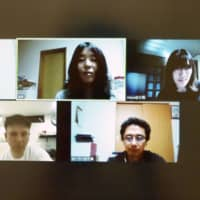 A video screen shows single fathers and mothers holding an online session on May 10 to discuss various problems associated with the new coronavirus pandemic. | KYODO