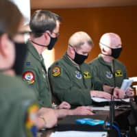 Aviators from the 37th Bomb Squadron receive a final mission briefing before launching a B-1B bomber from Ellsworth Air Force Base, South Dakota, on April 28. The crew flew two B-1Bs from the continental United States and conducted operations over the South China Sea as part of a joint U.S. Indo-Pacific Command and U.S. Strategic Command Bomber Task Force mission. | U.S. AIR FORCE