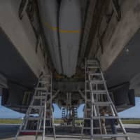 A B-1B bomber has one of its weapons bays loaded with stealthy Joint Air-to-Surface Standoff Missiles (JASSMs) at Andersen Air Base on the Pacific island of Guam on May 9. | U.S. AIR FORCE