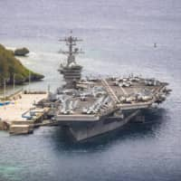 The aircraft carrier USS Theodore Roosevelt is moored pierside at the naval base on the Pacific island of Guam on May 15.   U.S. NAVY