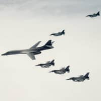 U.S. military faces down two challenges in western Pacific: COVID-19 and China