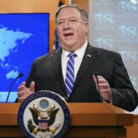 U.S. Secretary of State Mike Pompeo speaks about the coronavirus during a news conference at the State Department in Washington on May 6. | POOL / VIA AP