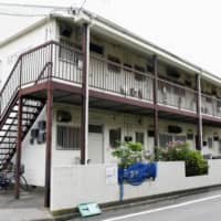 An apartment building in Tokyo's Adachi Ward where a man was stabbed to death over a noise complaint earlier this month | KYODO