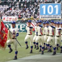 Seiryo High School, from Ishikawa Prefecture, marches during the opening ceremony for the National High School Baseball Championship on Aug. 8, 2019, in Nishinomiya, Hyogo Prefecture. This year's tournament was canceled on Wednesday because of the coronavirus outbreak. | KYODO