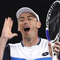 John Millman reacts during a match against Roger Federer at the Australian Open on Jan. 24 in Melbourne. | AP