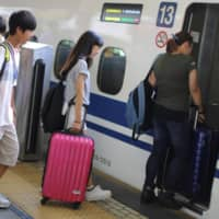 Japan's bullet trains begin asking passengers with large bags to reserve luggage space