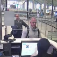 This Dec. 30, 2019 image from security camera video shows Michael L. Taylor, center, and George-Antoine Zayek at passport control at Istanbul Airport in Turkey. | DHA VIA AP