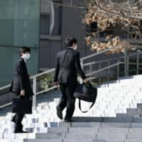 College students wear masks during visits to companies in Tokyo as the year's job-hunting season officially begins, on March 1, 2020, amid the new coronavirus pandemic. | KYODO
