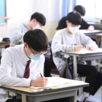 High school students take an exam in Seoul on Thursday.  | YONHAP /VIA REUTERS