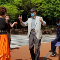 Seniors dance at park in Seoul on Tuesday.  | REUTERS